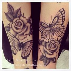 The roses in this tattoo are beautiful
