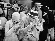 Ann Christy and Harold Lloyd enjoy a snack at Coney Island in Speedy, 1928 no 2 of 2