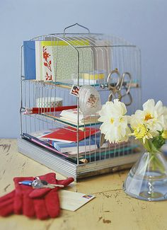 Lately I've been into bird cages but didn't know what I would do with one if I had it.  Look at this clever office supply organizer!