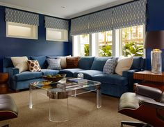 Blue, while the driving force in this room, is not overpowering when balanced with a neutral rug, brown chairs, and a lucite and chrome coffee table. - Traditional Home ®/ Photo: Matthew Millman / Design: Palmer Weiss