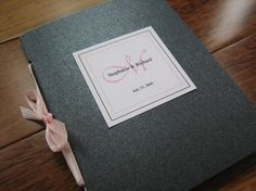 Wedding Program Booklets with Ribbon Closure and Monogram Tag- Set of 25. $33.75, via Etsy.