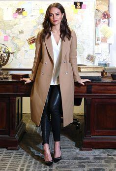 Camel coat, black leather pants and black heels