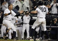 New York Yankees' Alex Rodriguez, left, celebrates with Francisco Cervelli (40) and Ichiro Suzuki, right, of Japan, after Cervelli scored on an RBI single from Raul Ibanez in the 12th inning of a baseball game against the Boston Red Sox, Tuesday, Oct. 2, 2012 in New York. The @New York Yankees won 4-3. @Major League Baseball