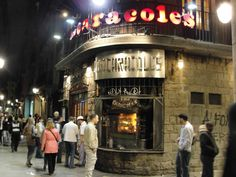 """""""Los Caracoles"""" Restaurant.  In 1835, the Bofarull family founded one of the most charismatic restaurants in the city, Can Bofarull, in the most emblematic part of the Gothic District, near Las Ramblas in Barcelona. Since then, four more generations of the Bofarull family have managed to maintain the excellent standard of its high quality traditional cooking. Address: c/.Escudelleres, 14   Barcelona 08002 http://www.loscaracoles.es"""