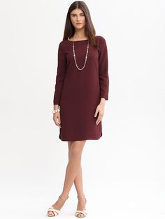 I just bought this Banana Republic dress and am styling it like a tunic, with a brown belt and boots, leaving the zippers on the sleeves unzipped to give the sleeves a different effect (I'm not into bracelet-length sleeves at all). I also intend to try it with black leggings and some other kind of shoe.