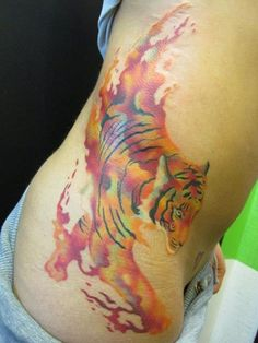 "Watercolor Tiger tattoo ... I love this. I want it. And I want it to say ""I earned my stripes"" by my stretch marks. <3"