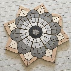 Work in progress - this is the middle pattern for the Roman mosaic bistro table - what do you think of it so far. Mosaic Pots, Mosaic Backsplash, Mosaic Diy, Mosaic Garden, Mosaic Ideas, Foyer Flooring, Mosaic Tile Designs, Mosaic Stepping Stones, Mosaic Pieces