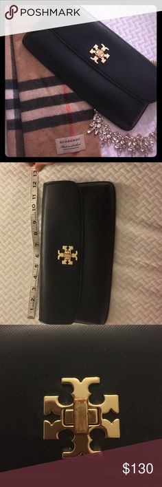 Tory Burch black and gold clutch. Tory Burch black and gold clutch. Inside and exterior leather in near perfect condition. Gold plating was damaged on the knob. View pictures for details.                                                                                                 Reasonable Offers welcome!  Bundles Welcome! Tory Burch Bags Clutches & Wristlets