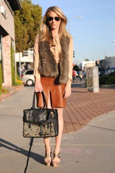 leather skirt and fur vest