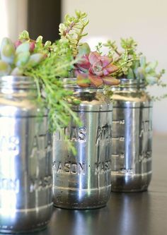 Repurpose empty jars with Krylon mirror spray paint for a vintage feel.