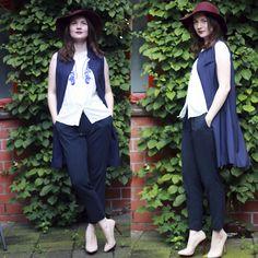 nude heels, burgundy hat,navy long vest
