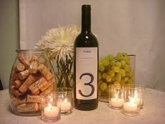 Centerpieces don't have to be identical - I love this grouping for a vineyard wedding.