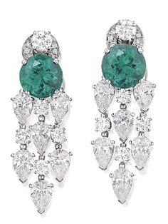 Pair of emerald and diamond earrings, Bulgari, each centring on a round modified brilliant cut emerald together weighing 8. 23 carats suspending three pear shaped and three round brilliant cut diamond drops, the diamonds together weighing 11.55 carats, mounted in 18ct white gold, signed Bvlgari