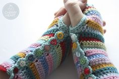 Cherry Heart: Stripy Mitts lovely use of buttons and a great pattern to put them on.