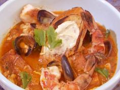 Get Fulton Fish Market Cioppino with Sourdough Croutons Recipe from Food Network
