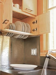 By combining a drying rack with a cabinet, crucial storage space can be maximized in small kitchens