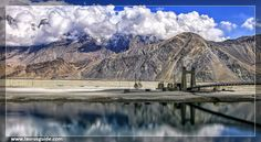 The Shyok River runs through the Shyok valley and finally meets the Nubra River forming the Nubra Valley of Jammu and Kashmir. Nubra Valley is located at a distance of 150 km from Leh-Ladakh.  The Shyok River is a tributary of the Indus River that originates in the Rimo Glacier, which is a part of the Siachen Glacier. The way the Shyok River flows is a little unusual, as it flows toward southeast and joins the Pangong Range and then it turns northwest and flows parallel to its original…