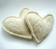 pocket warmers - tutorial  1. cut a three inch heart from an old sweater  (perhaps purchase one from goodwill)  2. fill with rice   3. stitch closed   4. heat in microwave for twenty five seconds, the place in pockets when going out into cold weather, will stay warm for up to one hour