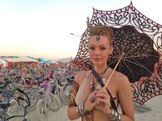 Umbrellas were used more as a fashion accessory than to keep the sun away. Burning Man Festival