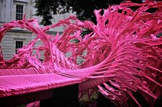"""""""Bloom"""", spiraling neon Olympic-sanctioned pink structure constructed of individual pieces that can be reconfigured into an array of new shapes, conceived as an """"urban toy"""" capable of fostering """"collective act[s] of imagination, search and play."""" - pavilion commissioned by the Greater London Authority for the London 2012 Olympic and Paralympic games, designed by Alisa Andrasek and Jose Sanchez from the Bartlett School of Architecture at UCL"""
