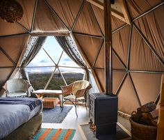 Enjoy the Patagonian wilderness in a cozy, igloo-style dome. EcoCamp is tucked away in the very heart of Torres del Paine National Park in Patagonia, Chile. Glamping, Casa Bunker, Interior Exterior, Interior Design, Bungalow, Geodesic Dome Homes, Dome Tent, Dome House, Cabana