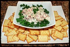 Cheeseball with Chicken in a Biskit crackers. (Roast beef, Green Onions, Spinach and 1/3 less fat Cream Cheese, 1T Worcestershire Sauce & 1T A.1. Steak Sauce per package of cream cheese used and fresh Parsley on top (not only for decoration but it is yummy added to each bite.) I had this growing up and now my family along with our guests LOVE it also :) Thanks for the recipe, Mom! J. Gurnee