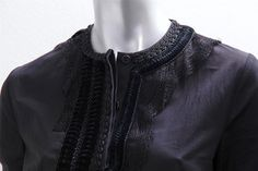 This long-sleeve cotton blouse by Givenchy has gorgeous details throughout. It features a rounded neckline, three buttons down the front, and pleats around the ends of the sleeves. There is an intricate lace, pleated velvet, and corded ribbon design around the neckline. | eBay!