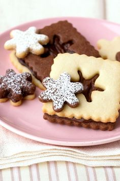 Sandwich rich homemade frosting between these chocolate-and-vanilla cookies. For cute mini cookies, bake, and frost the cut-out centers. Let the kiddos help cut out each design! #christmascookies #decoratedcookies #forkids #cuteholidaycookieideas #easy #bhg