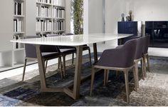 Mirá imágenes de diseños de Comedores de estilo moderno en blanco: Mesa Atlantis con tapa de cristal. Encontrá las mejores fotos para inspirarte y creá tu hogar perfecto.
