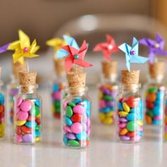 Pinwheel topped bottles with candy. Photo by Dot Coms for Moms