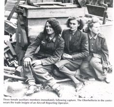 P.O.W.'s - Three female auxiliary members immediately following capture. The Oberhelferin in the centre wears the trade insignia of an Aircraft Reporting Operator.