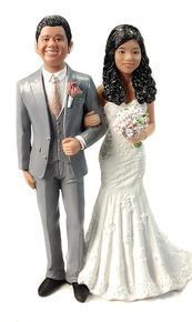 Charming Couple Cake Topper sculpted to look like the bride and groom!