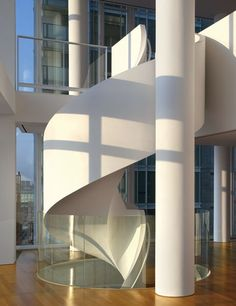 A staircase cork-screws through one of Richard Meier's Perry Street apartment towers (2002) in New York City