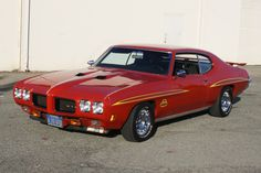 Red 1970 GTO Judge. Another one of my friends had this car. Her husband had a yellow one - same year.