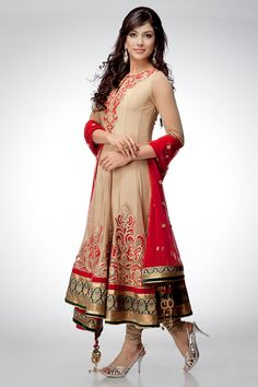 Add an alluring look to your style with this beige tussar anarkali. The kurta is enhanced with red embroidery and is edged with shimmer borders. The contrasting green brocade on the border of kurta and dupatta completes the look. Ring in any event with this dazzling ensemble.Shop online at www.satyapaul.com and Join our facebook page at www.facebook.com/SatyaPaulIndia