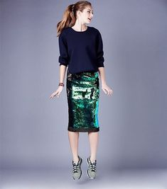 What Wear - Sequin skirts don't have to be synonymous with disco balls and American Hustle. Create a model-off-duty look by adding a slouchy knit top and colorful sneakers. Green Sequin Skirt, Sequin Skirt Outfit, Sequin Pencil Skirt, Pencil Skirt Outfits, Pencil Skirts, Fashion Mode, Modest Fashion, Skirt Fashion, Fashion Outfits