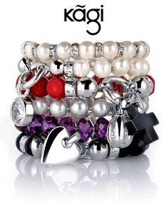 En van de armbanden, de parel-armbanden plus de paarse kruisbessen armband met hart hanger.