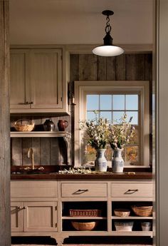 Sophisticated barnwood in the kitchen. John B. Murray Architect: Recent Work