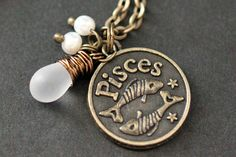 Pisces Necklace. Zodiac Necklace. Sun Sign Charm Necklace with Glass Teardrop and Pearls. Handmade Jewelry. by TheTeardropShop from The Teardrop Shop. Find it now at http://ift.tt/1mirnmk!