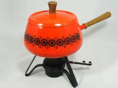 Tangerine Tango may be the 2012 color of the year, but orange was hot in the 1970s, too. Etsy seller Feed Your Soul offers this vintage fondue set in a bright orange color that will breathe life into any kitchen.