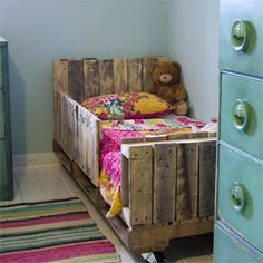 Lori danelle turned wooden pallets into an adorable bed for her daughter. (via Lori Danelle)