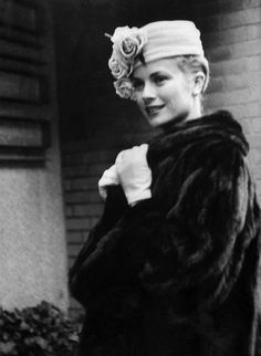 Grace Kelly was probably the most glamorous star of the 1950's. Here, cozy in a very unPC fur coat and a charmingly flowered hat, she continues to inspire fashion superlatives.