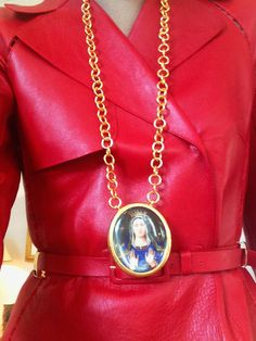 """""""This is a Noor Fares hand-painted pendant—I love how monastic it looks, especially against my red Valentino trenchcoat. And by the way, the only papessa in history was named Giovanna, in medieval times.""""  Giovanna Battaglia"""
