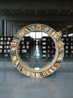 round bookshelve by nikolajnewyork, via Flickr