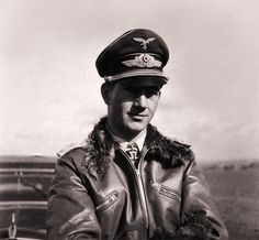 Hermann-Friedrich Joppien (1912-1941) was a German Luftwaffe fighter ace credited with 70 enemy aircraft shot down in roughly 270 combat missions, seen in his fleece-lined flight jacket, via Jedem das Seine. He claimed 42 victories over the Western Front, of which 23 were Supermarine Spitfires, the remaining victories were recorded over the Eastern Front. He was also a recipient of the Knight's Cross of the Iron Cross with Oak Leaves.