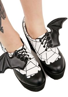 Iron Fist Daytime Sleeper Stomper Platforms ...ahh, the night has come at last. These intense platforms feature a sleek black 'N white vegan leather construction, bat appliques on the toe, webbed embroidery all over, ultra thick platforms, and bat wing details strung into the laces.