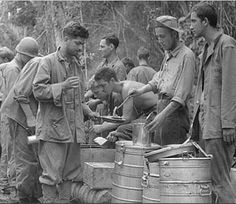 Marines just off the Guadalcanal perimeter line-up for hot chow. For most of its time on ther Canal, the First Marine Division encountered shortages of rations, forcing the Marines to subsist on a near-starvation diet. It took the Division nearly a year to recover for Guadalcanal.