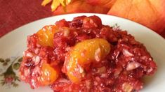 A cranberry gelatin salad is made with fresh cranberries, mandarin oranges, and pecans for a tangy, fruity flavor and a nutty crunch.