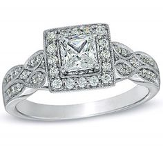 Your true love awaits, do not keep her waiting any longer, find her true desires answered with this beautiful Glamorous Cheap Engagement Ring. This Diamond Ring can be customized to 10k, 14k or 18k Yellow Gold, White Gold or Rose Gold. The center diamond can your choice of Round cut or Princess Cut. This ring comes with a lovely Jewelry box.