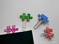 Funny bookmarks made with old puzzle pieces and paperclips